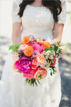 hot pink and orange bouquet #bride #bouquet #weddingchicks http://www.weddingchicks.com/2014/03/25/hot-pink-and-purple-two-day-wedding/