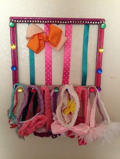 Made this for my little girls bows and headbands. DIY bow holder so easy and super cute.