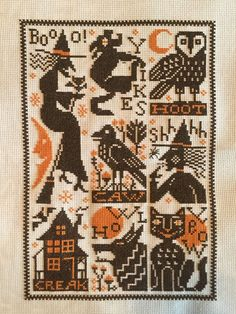 completed cross stitch Prairie Schooler Halloween witches sampler
