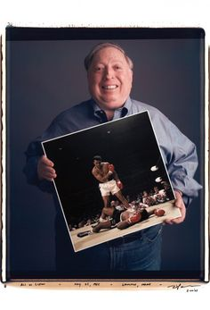 GOAT. Neil Leifer holds a print of his photo.