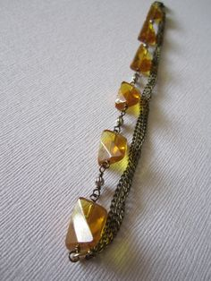 One Of a Kind Handmade Accessories!   Gold Chain Bracelet with Amber Colored Beads. $14.50, via Etsy.
