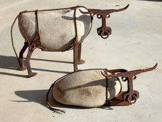 Cattle Artwork @ Fun is 2 cool. Cattle made from river rock, railroad spikes, railroad track, steel wire, and muts by artist John V. Wilheim.