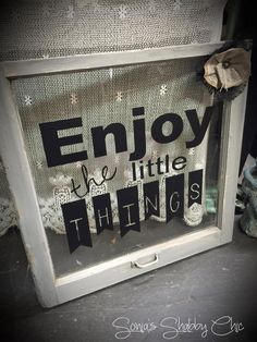 """Old wooden window cleaned up and turned into a cute whimsical sign that says """"enjoy the little things"""". Frame painted and distressed in Junk Monkey Chalk Style Paint and handmade burlap flower added for extra special touch!"""