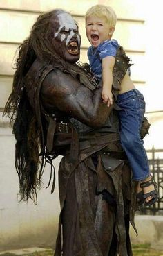 A Lord of the Rings Orc giving a cuddle to a curiously upset child. Some people just can't handle public displays of affection.
