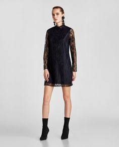 ... USD    Zara    High neck lace dress with long sleeves and interior  lining. Fastens at the back with zip hidden in the seam. HEIGHT OF MODEL   178 CM   e45be4de905