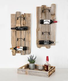 Store your wine bottles and then serve up a few glasses with this set made from handsome reclaimed wood for a rustic look.