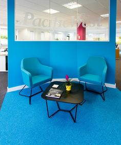 Blue office chairs. Waiting area at Pacific West offices. Designed by Interaction.