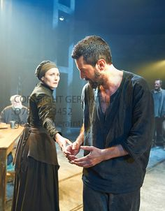 The Crucible by Arthur Miller, Richard Armitage and Anna Mandelay  There are so many emotions in this photo. Elizabeth knows he won't be coming home, John knows what he must do, Elizabeth loves and respects John, their last touch. John is stooped, he's broken a confessed sinner. He leaves his wife and children without protection...