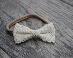 Charlie Cotton bow  This bow is either placed on a nude or white headband your choice. Headband is made out of nylon that will fit newborn to adult without leaving a mark. This can also be place onto a clip. This headband measures approx. 2 across & 1 1/4 wide. **This listing is for one headband or clip only****  **Please do not leave your child unattended while wearing acessory as there are small parts involved****  **All acessories are handmade so a slight variance in size may occu...