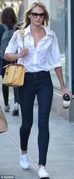It's in the jeans: Candice showed off her long legs in a pair of clinging denim trousers and a tucked ion white shirt #candiceswanepoel #shoppingpicks