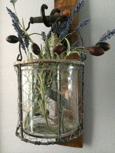 This oak wine barrel stave candle sconce is a beautiful addition to any decor. The hanging sconce includes a gorgeous rustic wire and glass