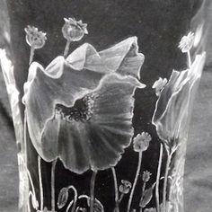 Poppies engraved onto a glass vase by Paul Amphlett. Shading done with Eternal Tools green stone burrs and whel polishers