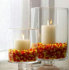 Halloween ideas, Halloween decorations, Here's one more for the grown up party but with a bit of whimsy.  Use candy corn instead of popcorn.  Try it with an Orange Pillar Candle or a Black Pillar Candle.  We have them in all colors and all sizes at BeverlyHillsCandle.com