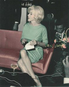 At her funeral, Marilyn's body lay in an open bronze casket lined with champagne-colored satin. Partially exposed, she was dressed in her green Pucci dress and a green chiffon scarf, a favorite which she had worn at a press conference in Mexico City earlier that year.