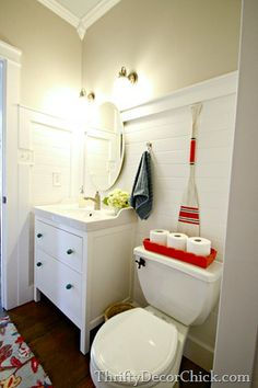 Thriftydecorchick.com     This bathroom redo is too cute-feels very bright and fresh. Good job, Sarah