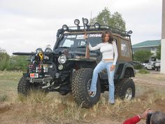 Can some please tell her to get out of the picture. She's blocking the view of the Jeep....