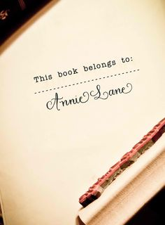 This book belongs to - Custom Calligraphy Wooden Stamp with Your Name - Bookplate - Saison Paris Style. $39.50, via Etsy.