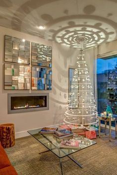 Pretty, sleek, modern design hoop tree - luv this! But still nothing better to me than a full green tree with lots of lights, garland & many, many ornaments :)