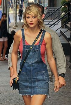 Taylor Swift Photos Photos - Singer Taylor Swift seen stepping out from her apartment wearing a mini skirt and no bra in New York City, New York on August 8, 2016. Taylor spent the weekend celebrating Karlie Kloss' birthday in the Hamptons. - Taylor Swift Steps Out in NYC