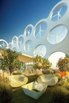 Thumbs up for sustainable solutions with design appeal! Wind turbine penthouse apartments.