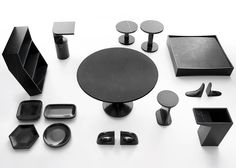 Work by the late James Irvine and other international designers were reproduced in black marble for this collection by Marsotto Edizioni