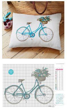 Cross stitch pillow of a retro bike.                                                                                                                                                      Mais