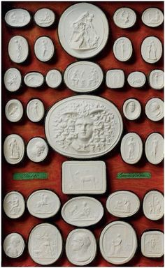 """Collection of moulds of engraved gems representing artworks and called """"Intaglios"""" from the Grand Tour Decorative Objects, Decorative Accessories, Cemetery Art, Objet D'art, Grand Tour, Wax Seals, Wedgwood, Mail Art, Wall Sculptures"""