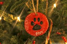 Super easy, homemade pawprint ornaments from www.crayonsandcollars.com. Your kids will love making these with you! <3