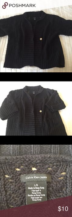 Calvin Klein knit sweater Black knit sweater. Sleeves come down slightly past the elbow. Heavy sweater and a great cozy, comfy sweater. Calvin Klein Sweaters Cardigans