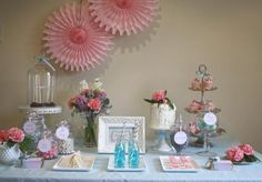 love the combo of sweets and flowers. the vases and dishes really add to the feel.