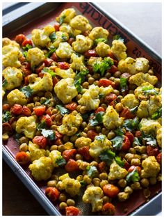 A quick and healthy side dish with roasted cauliflower, grape tomatoes, and chickpeas. Seasoned with Indian spices, this is one flavorful vegetarian dish!