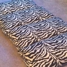 My version of the sleep-over pad, I used king size pillow cases, a lot less sewing. Just sew them together and stuff your pillows in, done!! Got the Zebra print @ BBB for 70% off. Washable, too! kids-stuff