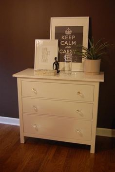 white dresser used for changing table and storage!