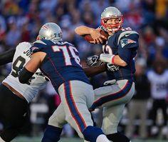 New England Patriots quarterback Tom Brady elude New Orleans Saints defensive end Cameron Jordan (94) as Patriots tackle Sebastian Vollmer