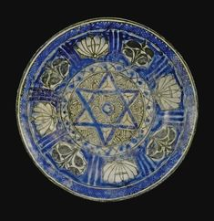 A Rare Mamluk Blue and White Dish with Six-pointed Star, Egypt or Syria, <P>14th century</P> | Lot | Sotheby's