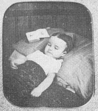 Posed with an open book. ---  Victorian Post Mortem-hard to look at these photos for to long,,,though a reality to all,just sad to see the very young posed for one last picture.ouch :(