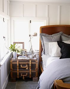 Like the suitcase side table & table lamp used in this boy's bedroom.  Color scheme has nautical feel.