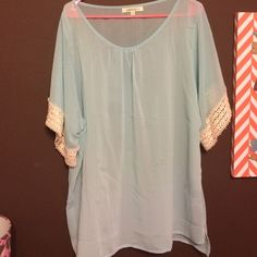 Light Blue Umgee Plus Size Top (boutique top) Light blue, see through, beautiful design on sleeve....worn one time! Umgee Tops Blouses