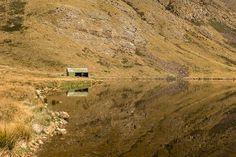 The historic musterers hut on the shore of Lake Emma in the Hakatere conservation park. Officially our new favourite picnic spot in New Zealand. Picnic Spot, South Island, Conservation, New Zealand, Reflection, Hiking, Outdoors, Adventure, Mountains
