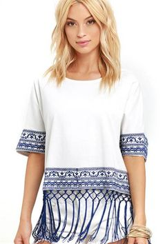 This blue and white kaftan top with fringe is perfect for summer. it looks great with white shorts or pants.