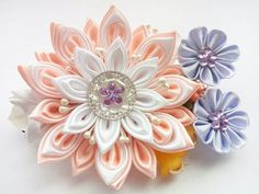 This hair accessory is created on the basis of a metal barrette and decorated with a peachy white flower. It is created of satin ribbons using kanzashi technique. 100% handmade for sure! About 3,54 inches length of the entire flower arrangement  Ready to ship