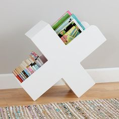 No need to search a treasure map if you're looking for a unique book caddy.  We've marked it with an X.  Actually, we designed the whole caddy to look like an X.  Its versatile open storage not only works for books, but can also accommodate toys, as well.  And the painted white finish means it'll match the décor of nearly any room in your home.