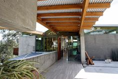 Patio cover with corrugated metal roofing.