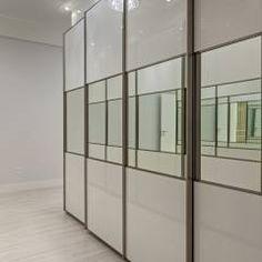 Casa Orquídea: Closets Moderno por Arquiteto Aquiles Nícolas Kílaris