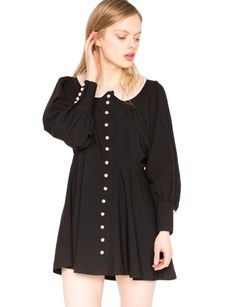 Super cute little black dress featuring bubble sleeves with beige collar. Button closure down front. Looks pretty with Wiley booties. *100% ...