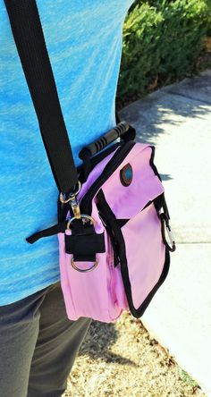 """Urban Pack - Pink LGD2943 - PINK $23.00 Holds tablets up to 6"""" wide. It is the perfect bag for travel with a zippered back pocket to keep a passport against your body while juggling tickets and luggage. Packs flat, but expands up to 6"""". Includes rubber handle, belt loop, carabiner clip and loops for the adjustable nylon strap which can be used over the shoulder, across the chest or as a belt.   Dimensions: 6 """" x 9"""" x 2.5  COMES WITH -- LOVE THE LORD LOGO"""