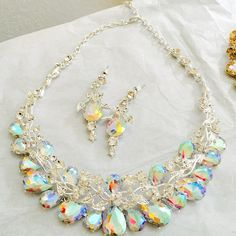 Your choice of Gold/ champagne or Silver/AB Set Gorgeous Rhinestone necklace set in your color choice!  Beautiful statement piece. New item comes gift boxed. Jewelry Necklaces