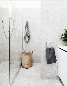 Modern Renovation Of A Melbourne Townhouse In the bathroom, the existing shower cubicle was converted into a laundry area and a new walk-in shower installed. In keeping with the home's sensibilities, terrazzo tiles were laid from floor to ceiling. Room Tiles, Bathroom Floor Tiles, Shower Floor, Bathroom Grey, Shower Base, Shower Walls, Bathroom Towels, Modern Bathroom, Shower Grout