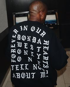 Kanye West releases his latest piece of merch: a black crewneck pullover printed with a memorial to the late Donda West as some may recall from the TIDAL press conference last year. Click the link in bio for more information. by hypebeast