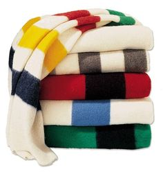 Hudson Bay Blankets from the Hudson Bay Company are wool blankets that are still loomed in England. These Hudson's Bay Point Blankets will last not just a lifetime but generations. Hudson Bay Blanket, Bay Point, Fur Trade, Camping Blanket, Unique Outfits, Wool Blanket, Cool Stuff, Pendleton Blankets, Vintage